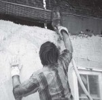 "Mud arrives cleanly and directly through the homemade ""power trowel"" attached to a stucco pump."