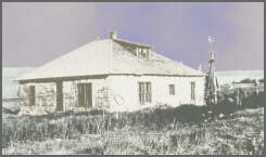 "The Monhart home, built in 1925, is shown here in the 1930s with ""gumbo mud"" falling from the walls."