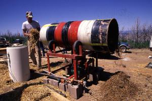 Alfred using his barrel straw-clay mixer