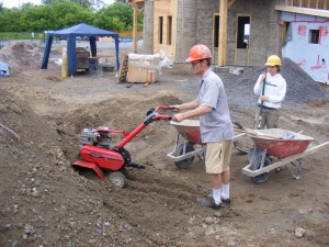 Basic tools turn dirt into plaster 1. A roto tiller is used to break up site soil prior to mixing.