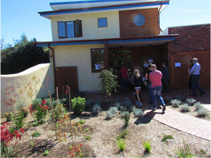 Visitors enjoying the open house tour of the Brighton strawbale residence.  Courtesy of John Connors