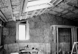 Straw-bale cottage during construction.