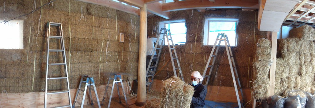 Straw bales stacked on the interior side of a conventional timber frame in Toyama City, Toyama Prefecture