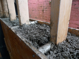 Hand-placed hempcrete cast around a central softwood frame