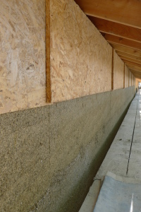 A hempcrete wall with shuttering partially removed.