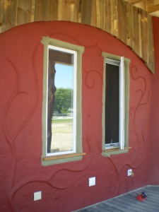 Artistic exterior clay plaster in an exterior application, using silicate mineral paints for weather protection