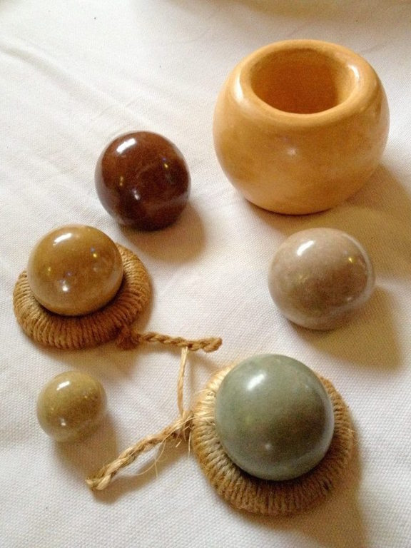 Polished clay balls made from colored clays in Thailand