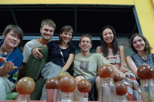 Six people from as many countries enjoying the art of polishing clay balls!