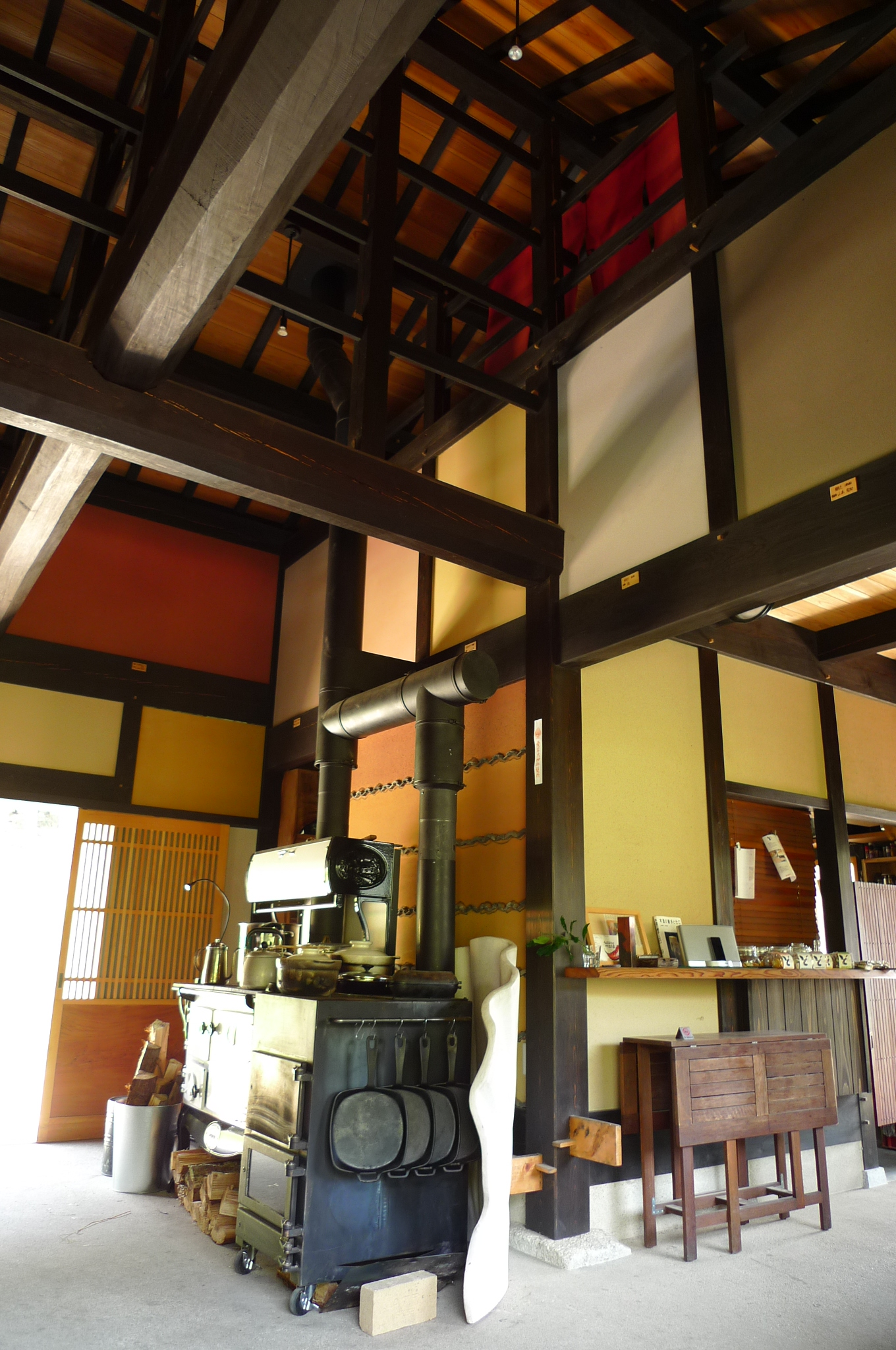 A beautiful timber frame structure with traditional bamboo lattice and earthen plaster walls